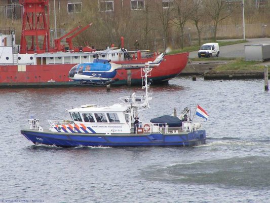 police vessel and helicopter