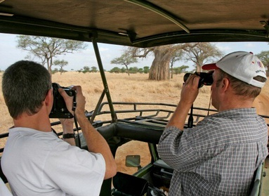 Fly drive safari vehicle with open roof in Africa