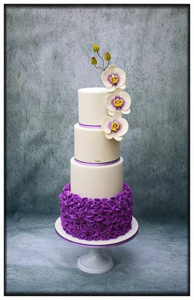 white purple wedding cake orchids