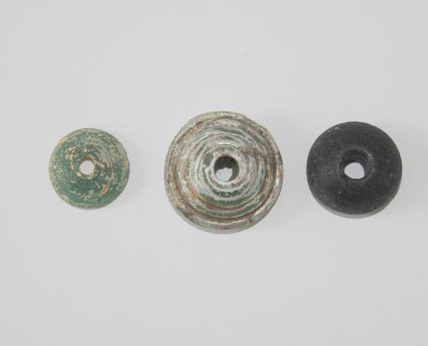 drop-spindles-from-glass-roman-period.large.jpg