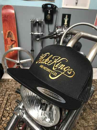 Gold embroidered black, snap back, trucker cap. LOW!