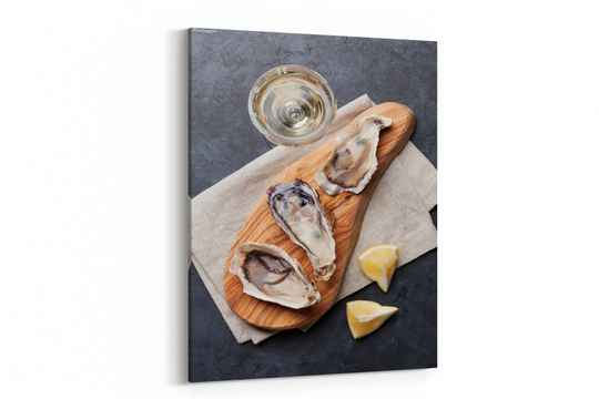 Opened oysters, ice and lemon and white wine