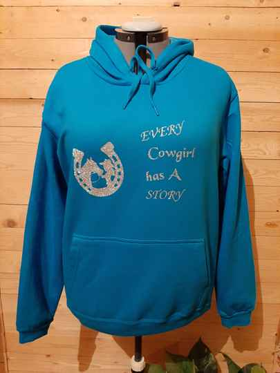 Hoodie 'Every cowgirl has A story'