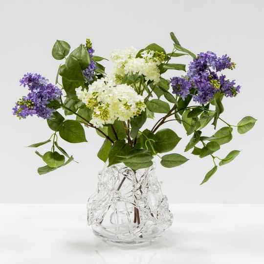 Glass vase with lilacs
