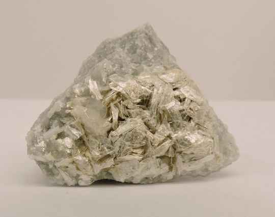 Talc and calcite on matrix from France - miniature