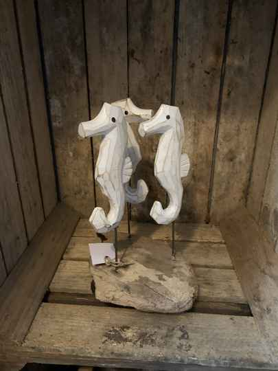 Wood base with 3 sea horse.