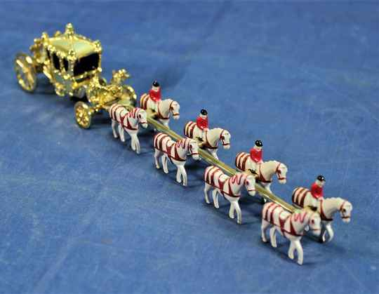 Matchbox No. YY66 'Her Majesty's Gold State Coach'.
