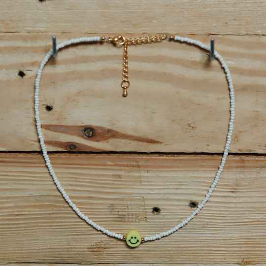 White smiley necklace