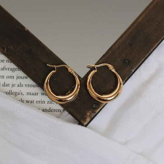 Golden earrings hoops arched