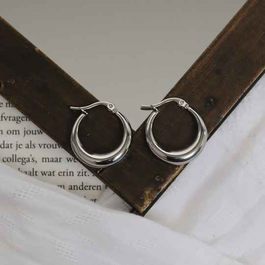 Silver earrings hoops arched