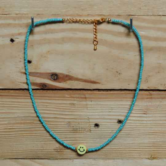Blue smiley necklace