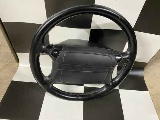 964 steering wheel including airbag