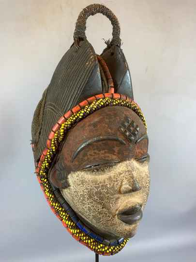 210249 - Tribal used Old African female mask from the Punu with Cap - Gabon.
